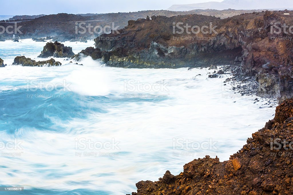 coast at Los Hervideros with huge waves in Lanzarote royalty-free stock photo