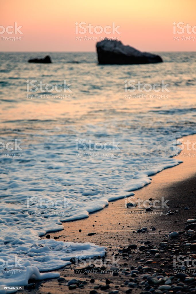 Coast before sunset near Petra Tou Romiou, Paphos District, Cyprus. Shallow depth of field. stock photo
