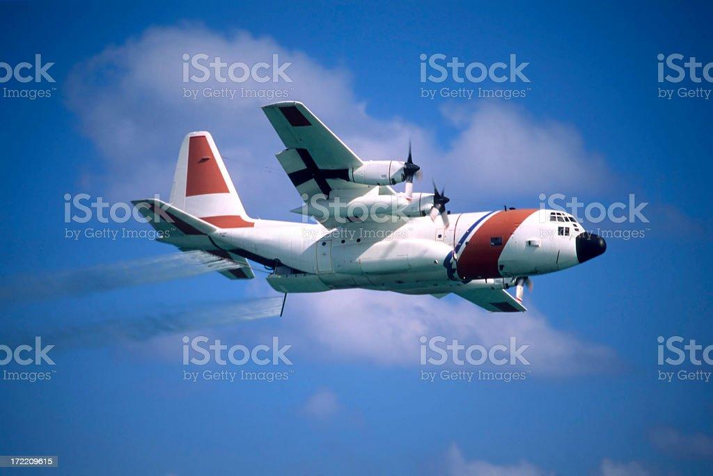 Coast Guard HC-130 flying with spray stock photo