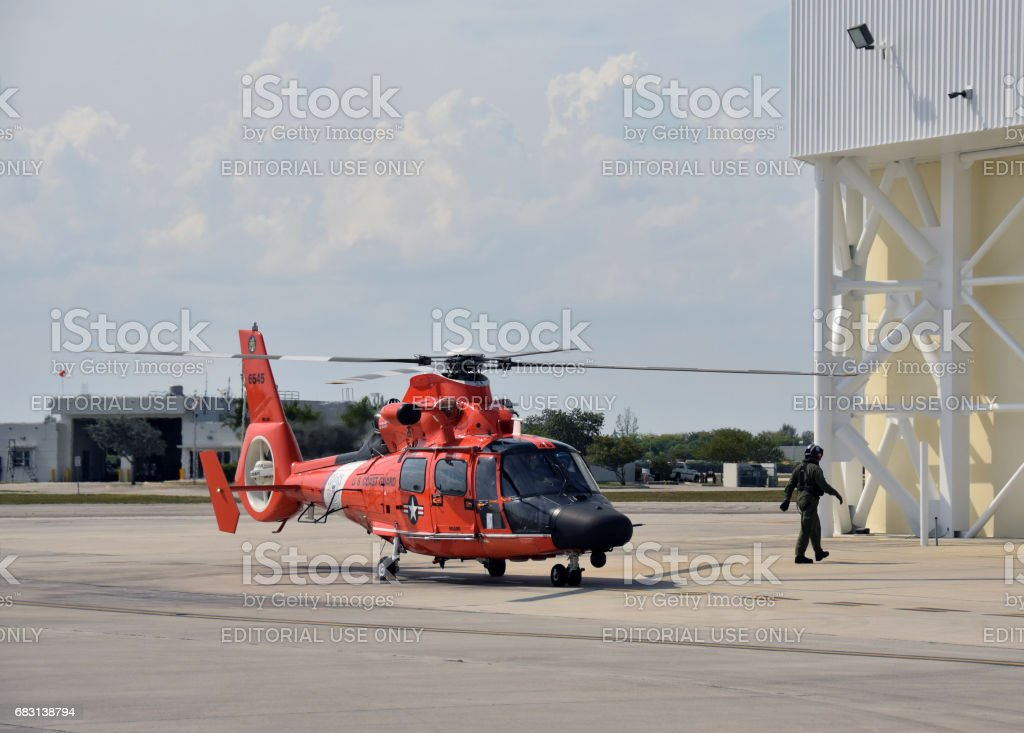 US Coast Guard helocpter returns from mission stock photo