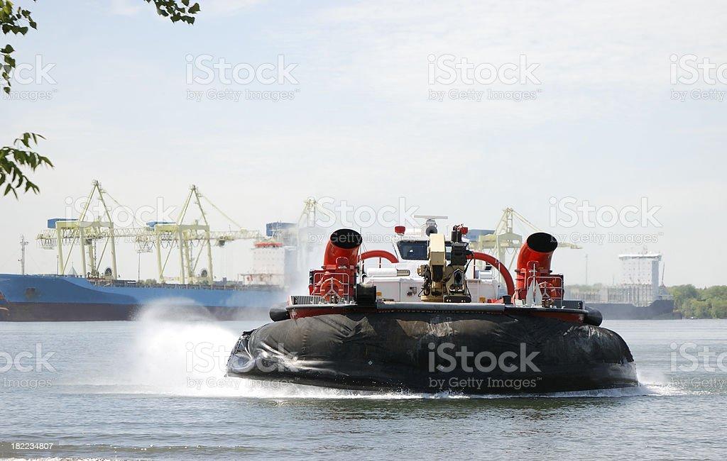 Coast guard hovercraft on water. stock photo
