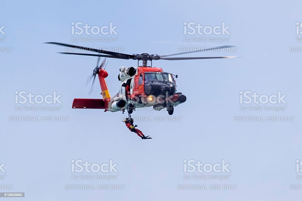 Coast Guard rescue helicopter and rescue diver stock photo