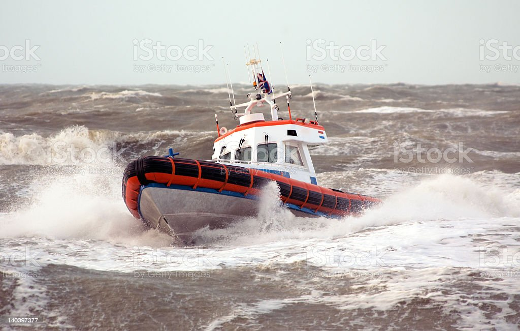 A coast guard ship on breaking waves royalty-free stock photo
