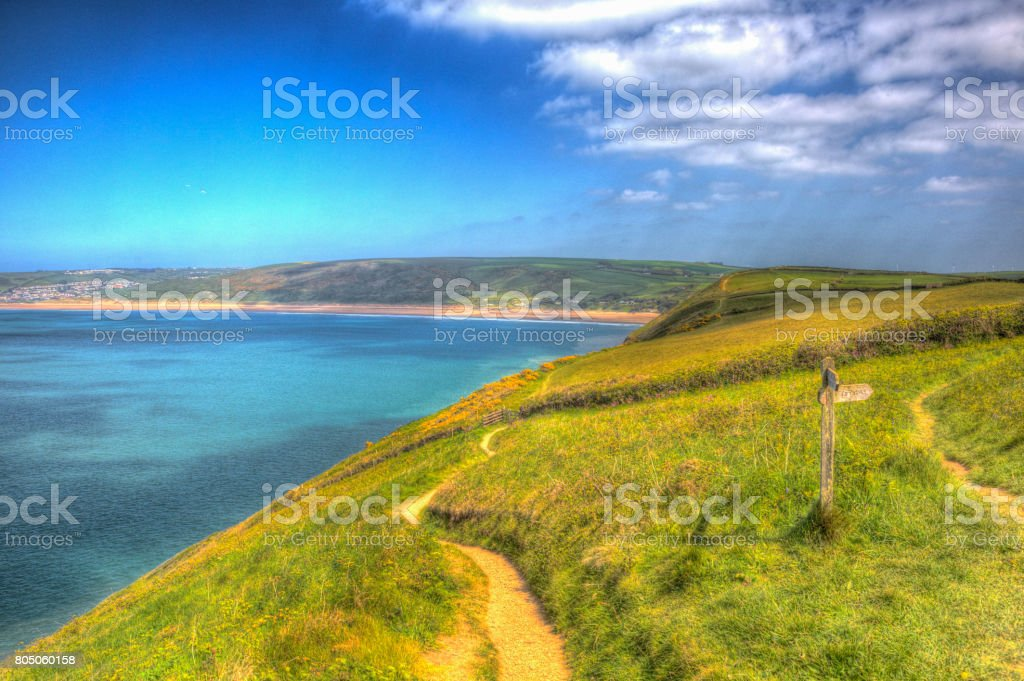 Coast path sign to Woolacombe Devon England UK in summer with blue sky stock photo
