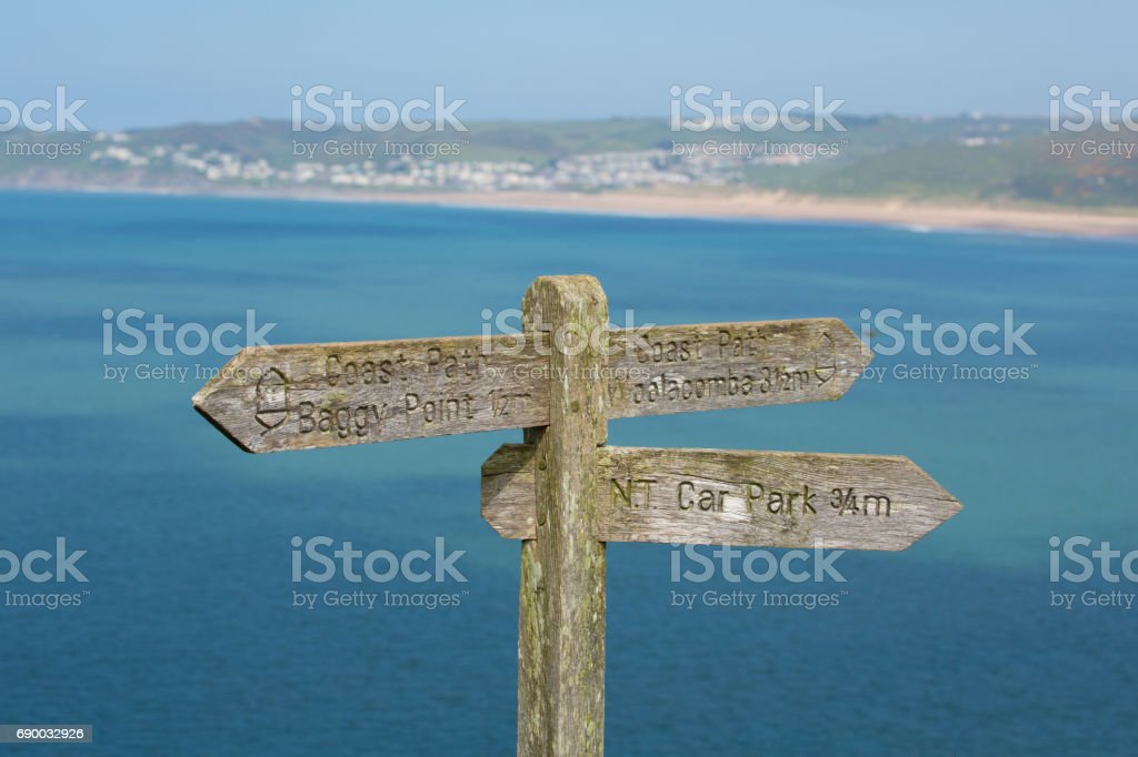Coast path sign to Woolacome Devon England UK in summer stock photo