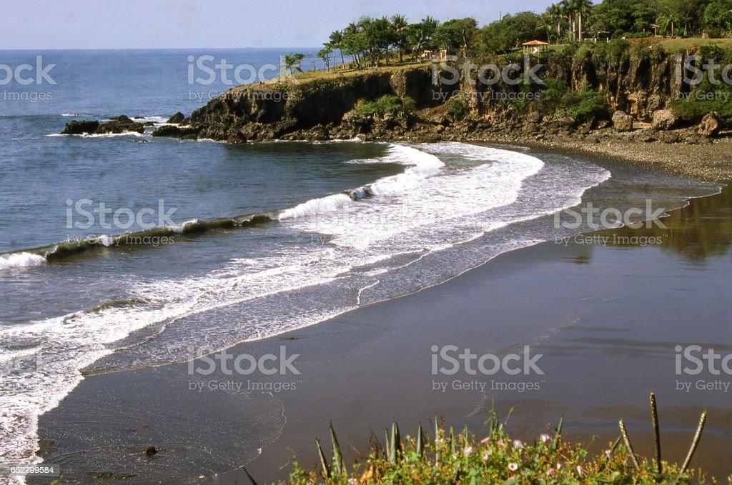 Coastal bay and beach with black sand from lava eruptions near La Libertad El Salvador Central America stock photo