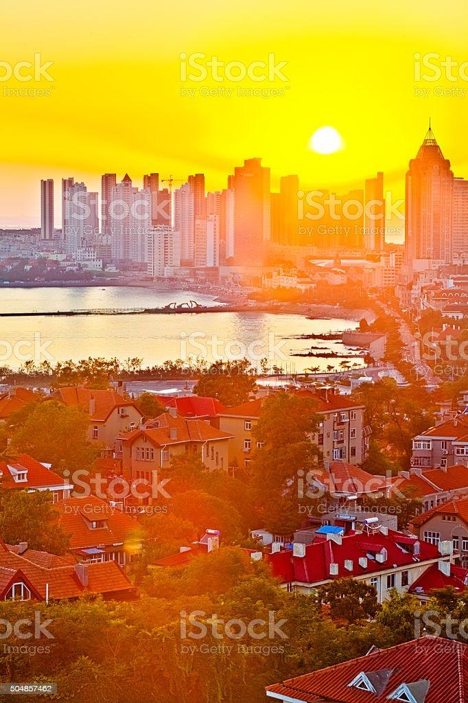 Coastal city at sunset stock photo