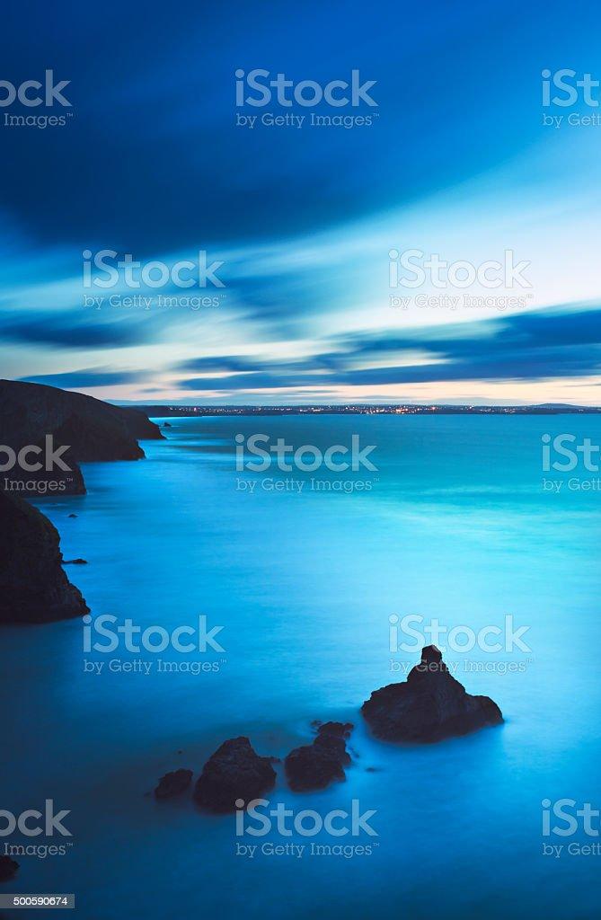 coastal cliffs at dusk - Bedruthan Steps - Cornwall stock photo