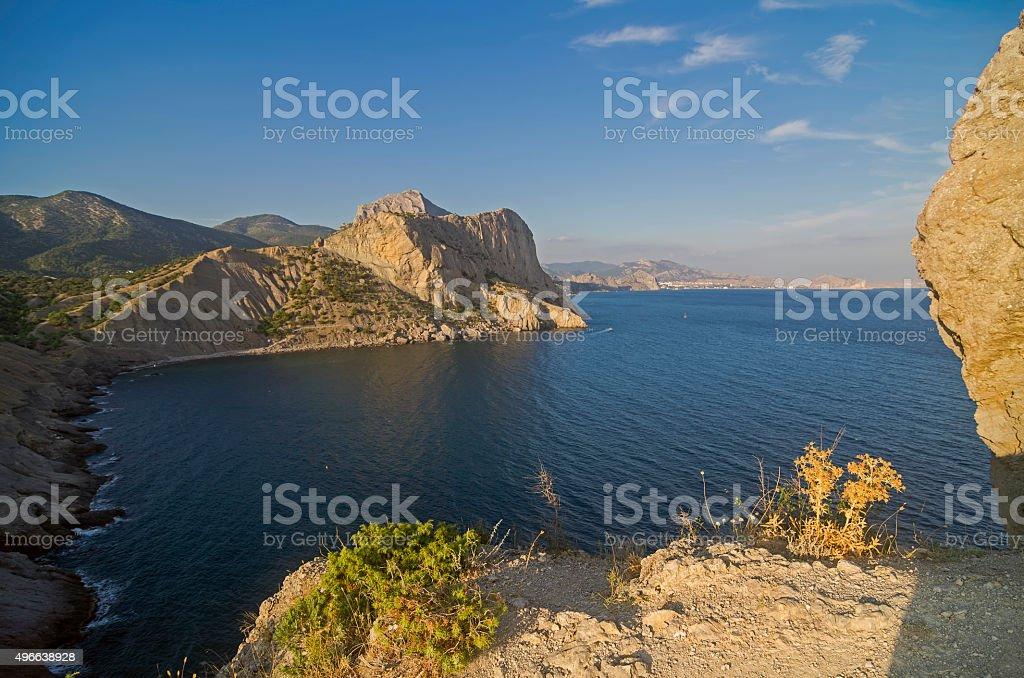 Coastal cliffs under the evening sun. Crimea. stock photo