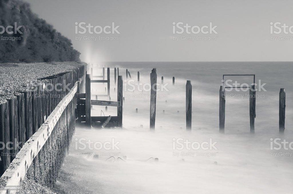 Coastal defences and groynes on Bawdsey beach, Suffolk, UK stock photo