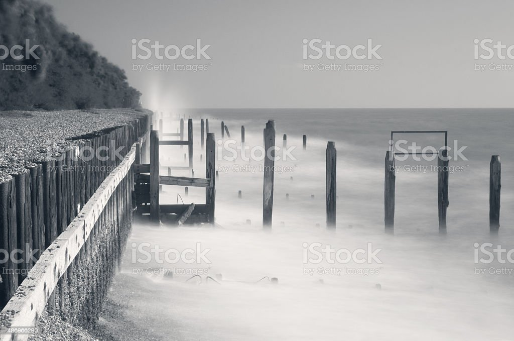Coastal defences and groynes on Bawdsey beach, Suffolk, UK stock photo