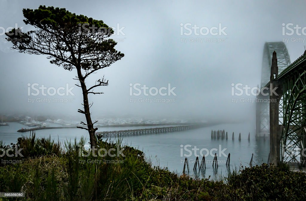 Coastal Fog Overtaking Yaquina Bay Bridge Newport Oregon River Mist stock photo