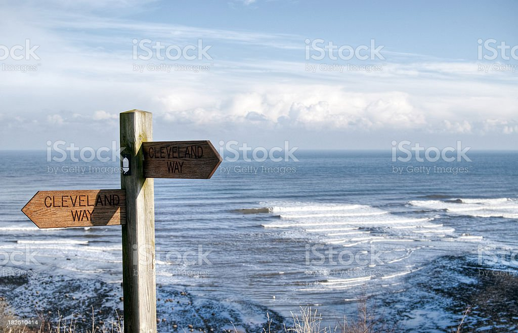 Coastal footpath sign with sea view royalty-free stock photo
