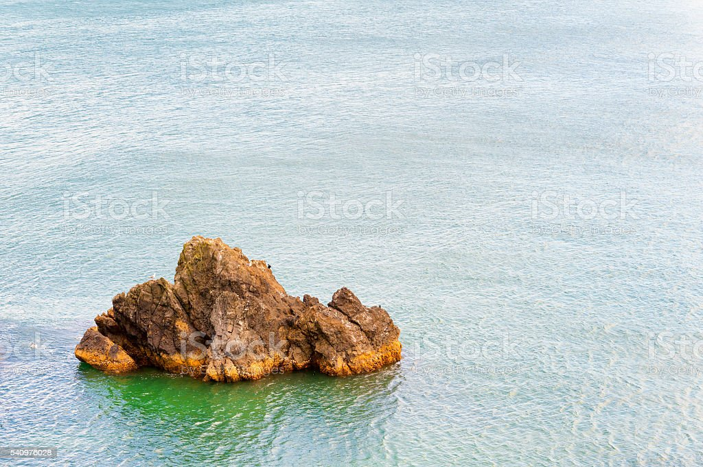 Coastal geological feature surrounded by water stock photo