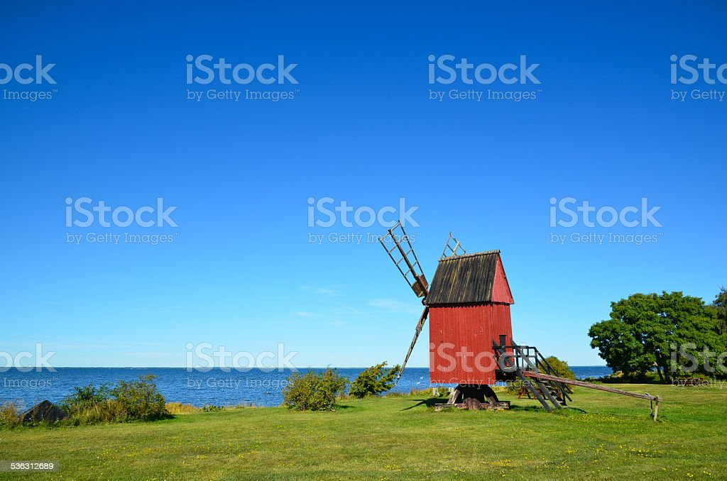Coastal old windmill stock photo