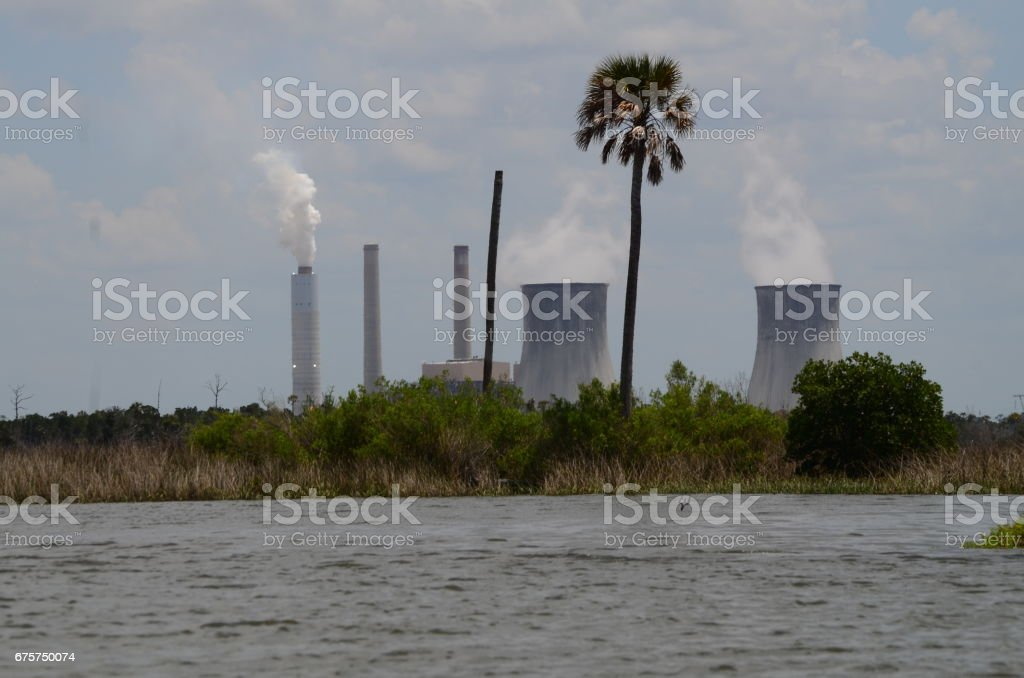 Coastal power plant with marsh in foreground stock photo