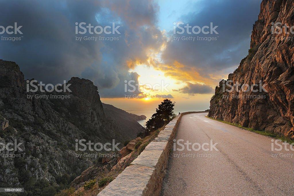 Coastal Road on the Island of Corsica at Sunset stock photo