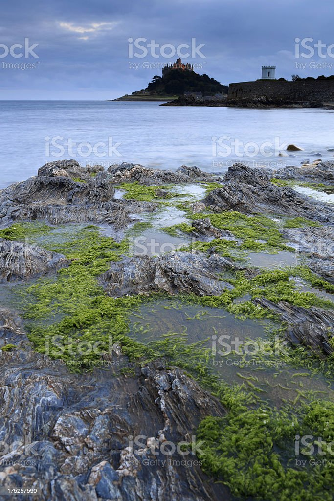 coastal rocks with St. Michael's Mount in the background royalty-free stock photo
