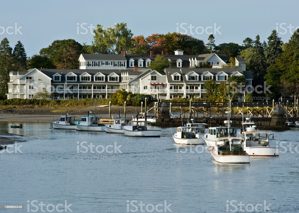 Coastal scene of boats entering loading dock stock photo