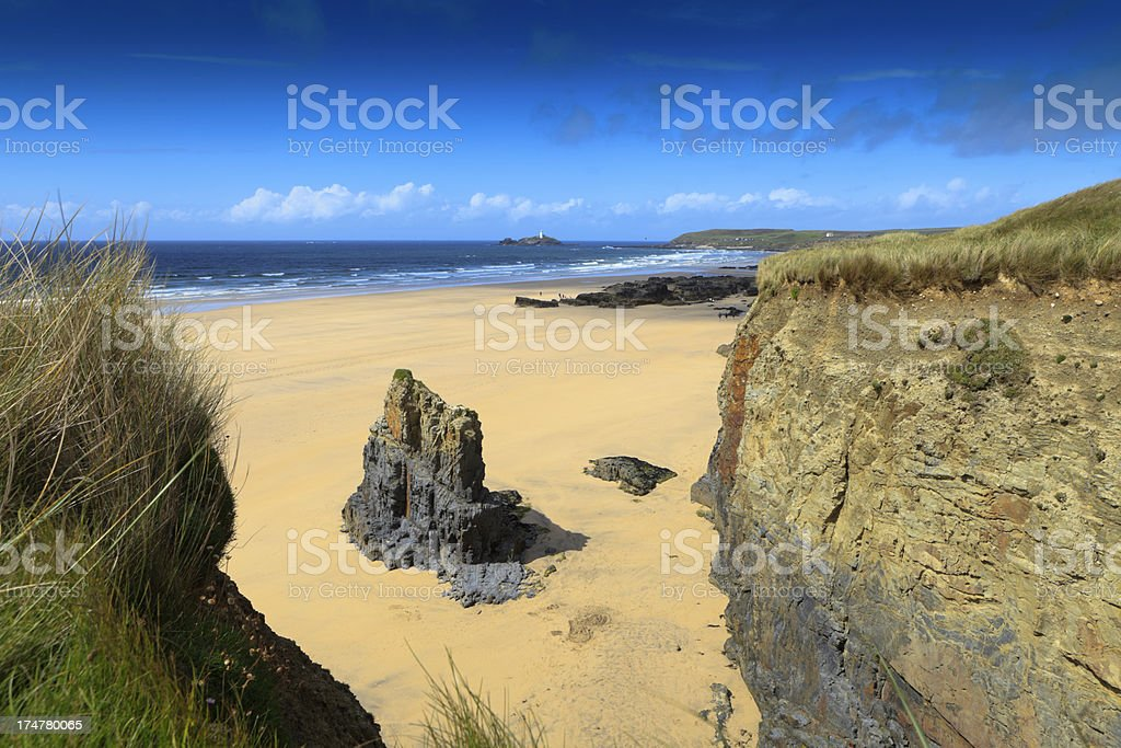 coastal scenery at Gwithian with Godrevy lighthouse in the backg stock photo