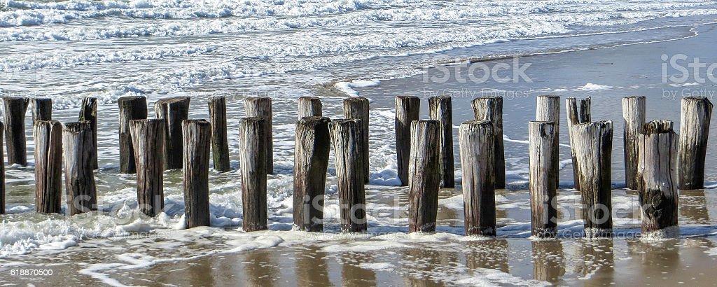 coastal scenery with wooden pillars stock photo