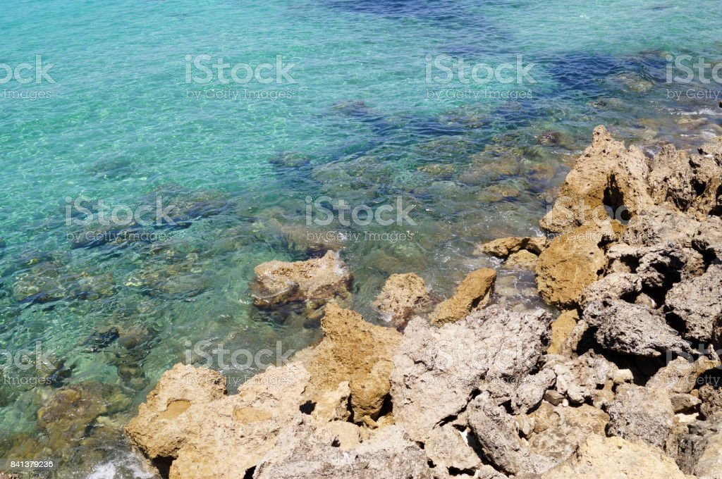 Coastal sea blue water and stones. Texture, background for a site, banner, text, label. stock photo