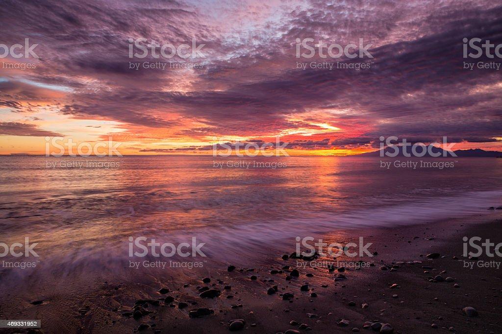 Coastal sunrise on the beach in Amed village in Bali stock photo