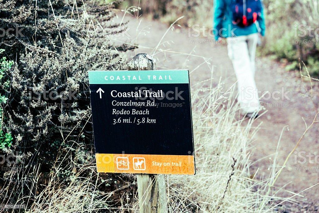 Coastal Trail sign with hiker, Marin Headlands, California stock photo