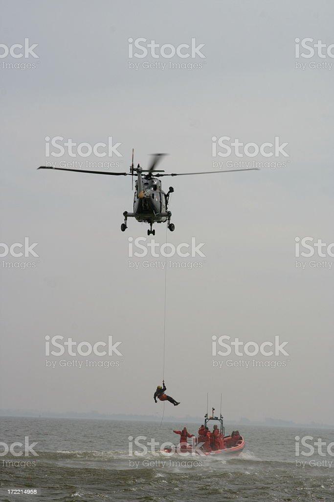 Coastguard performing SAR operation at sea stock photo