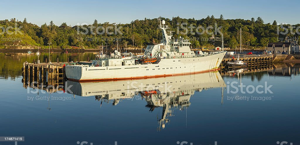 Coastguard ship moored in picturesque island harbour panorama royalty-free stock photo