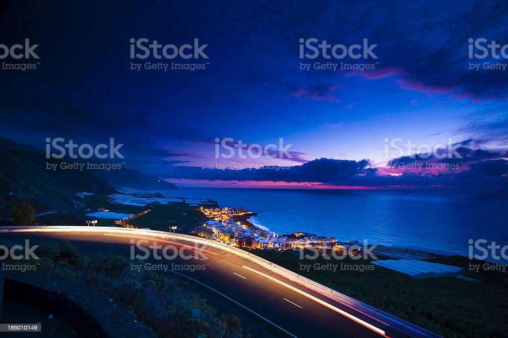Coastline after sunset stock photo