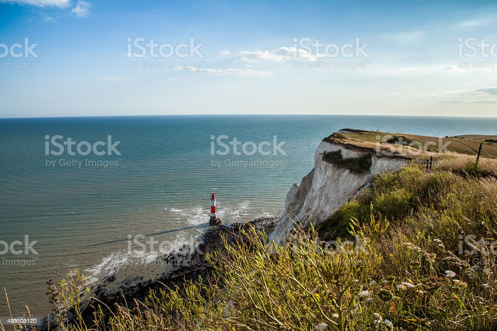Coastline and lighthouse at Seven Sisters cliffs in England stock photo