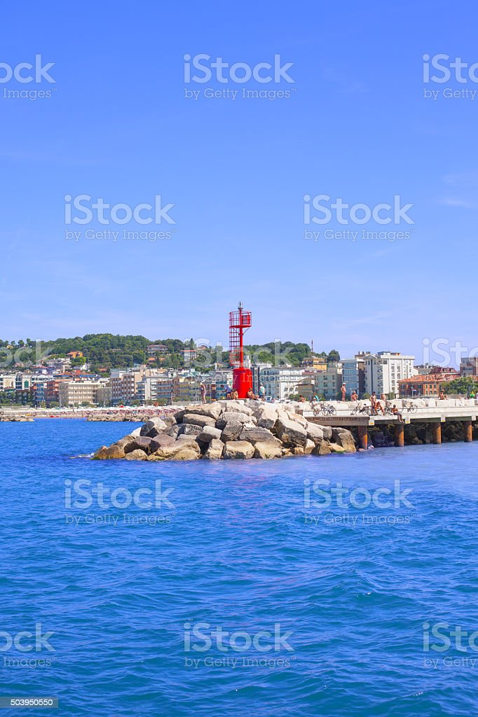 Coastline and lighthouse in the Bay of Angels. stock photo