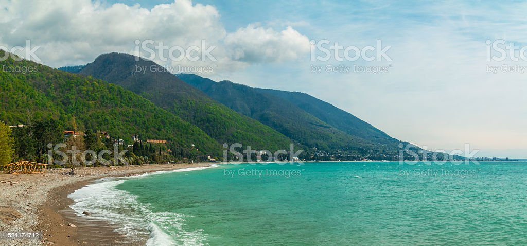 Coastline and mountains on sunny day stock photo