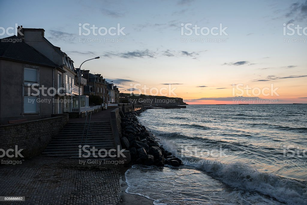 Coastline at sunset in Arromanches, Normandy, France stock photo