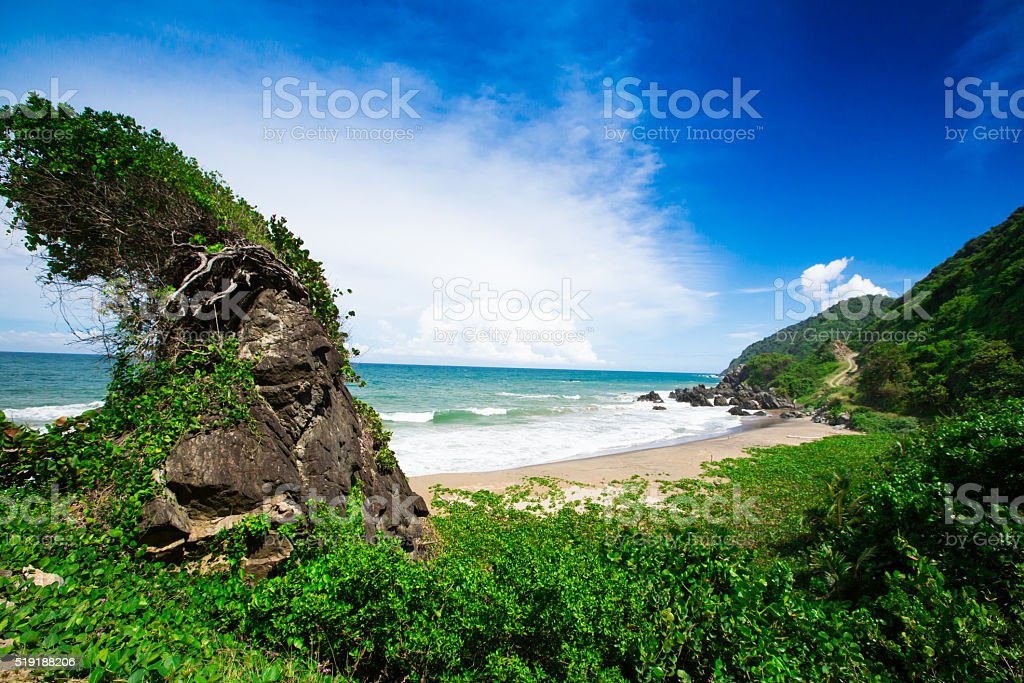 coastline at the foot of the mountains stock photo
