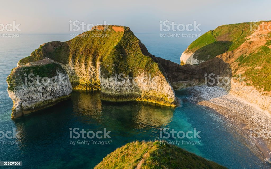 Coastline erosion along chalk cliffs in Yorkshire, UK. stock photo