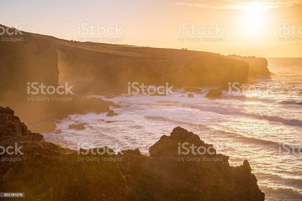 Coastline near Praia Da Bordeira beach at sunset, Portugal stock photo