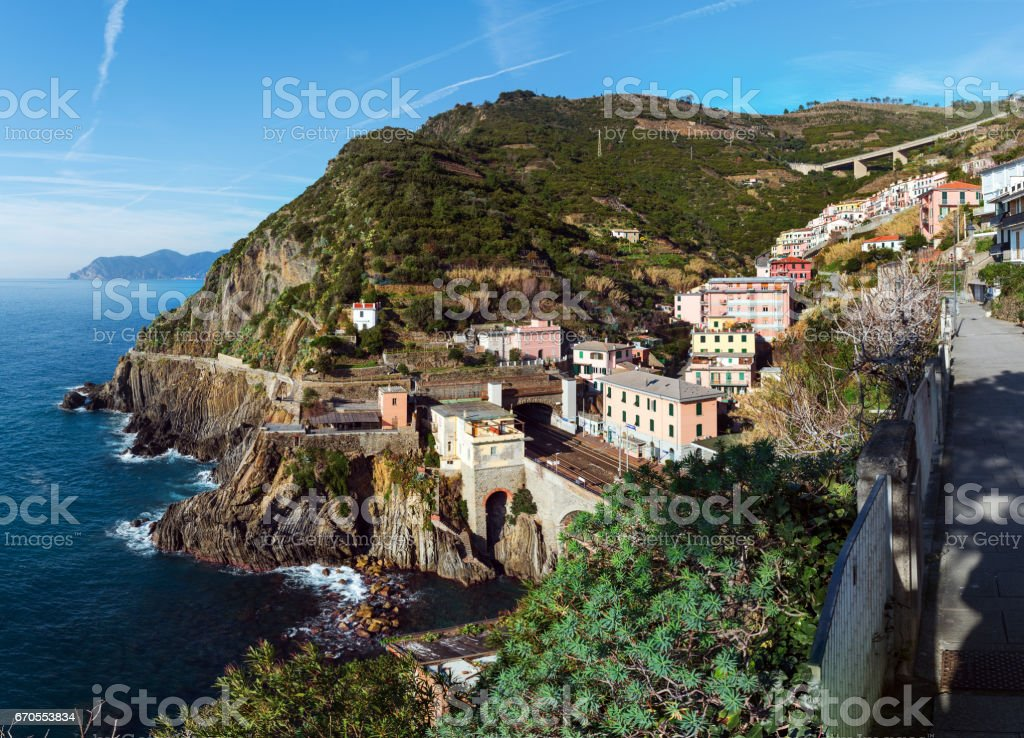 Coastline of Mediterranean sea at Riomaggiore town, Italy stock photo