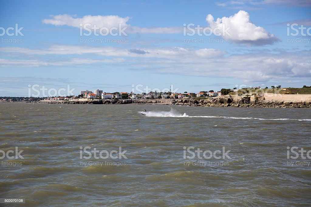 coastline with blue sky and fluffy white cloud stock photo