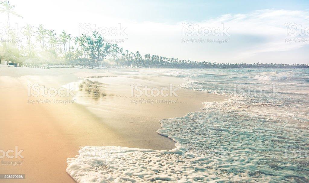 Coastline with waves, sand and haze stock photo