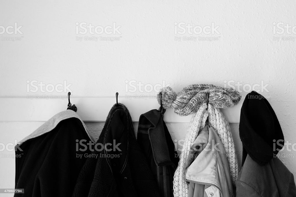 Coat and jackets on hangers stock photo