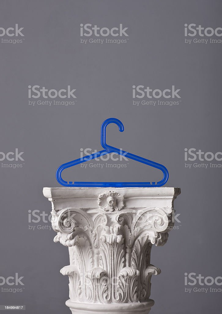 coat hanger on a corinthian capital royalty-free stock photo