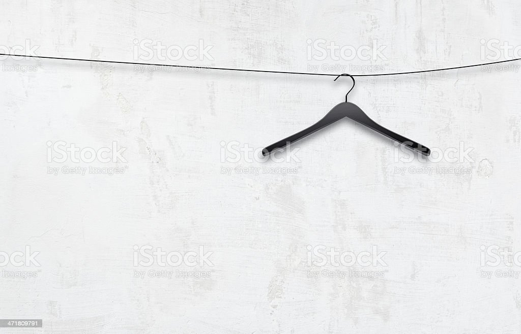 coat hanger on a white wall royalty-free stock photo