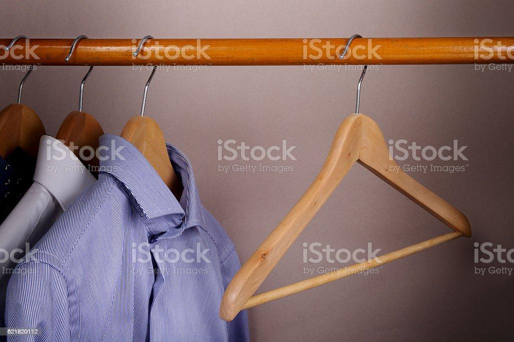 Coat hangers on clothes rack stock photo