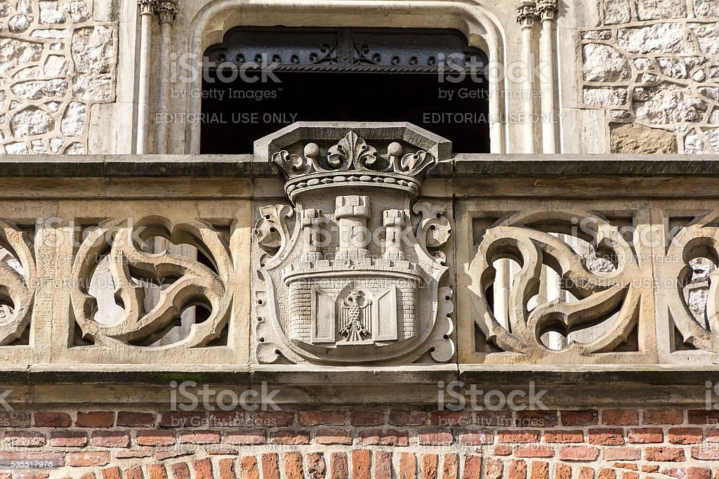 Coat of arms of Cracow-  carving on Florian Gate, Krakow, Poland stock photo