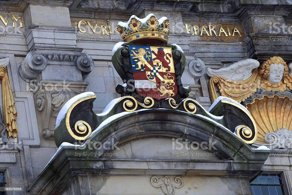 coat of arms on Delft's Town Hall in winter royalty-free stock photo