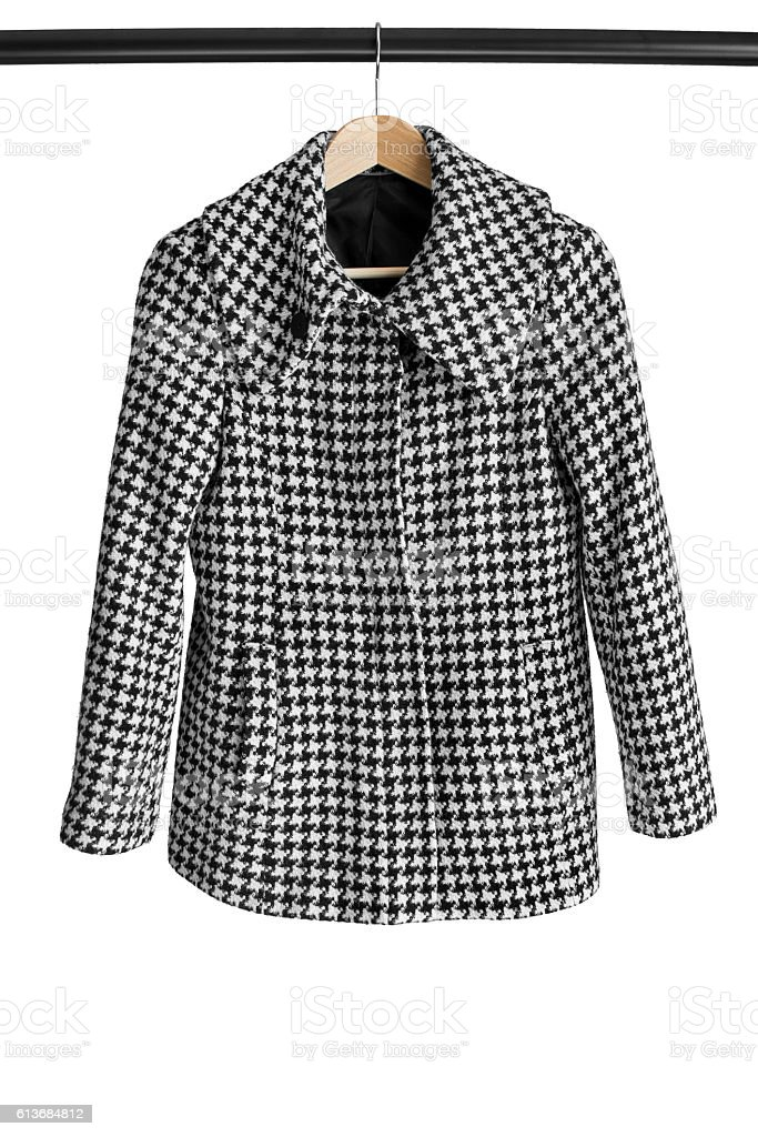 Coat on clothes rack stock photo