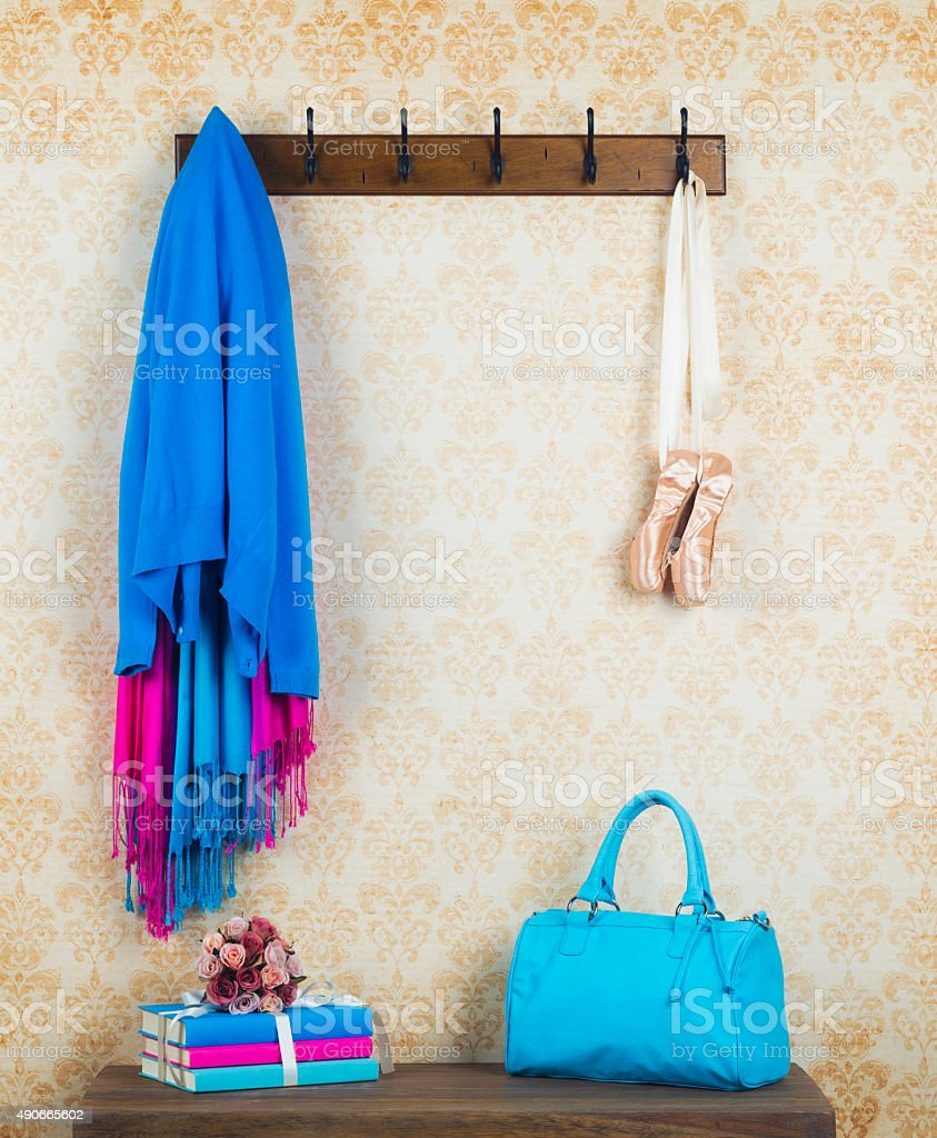 Coat rack and bench with accessories in home entry way stock photo
