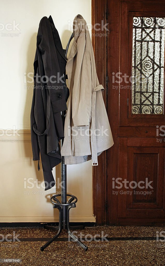 Coat rack with overcoats stock photo